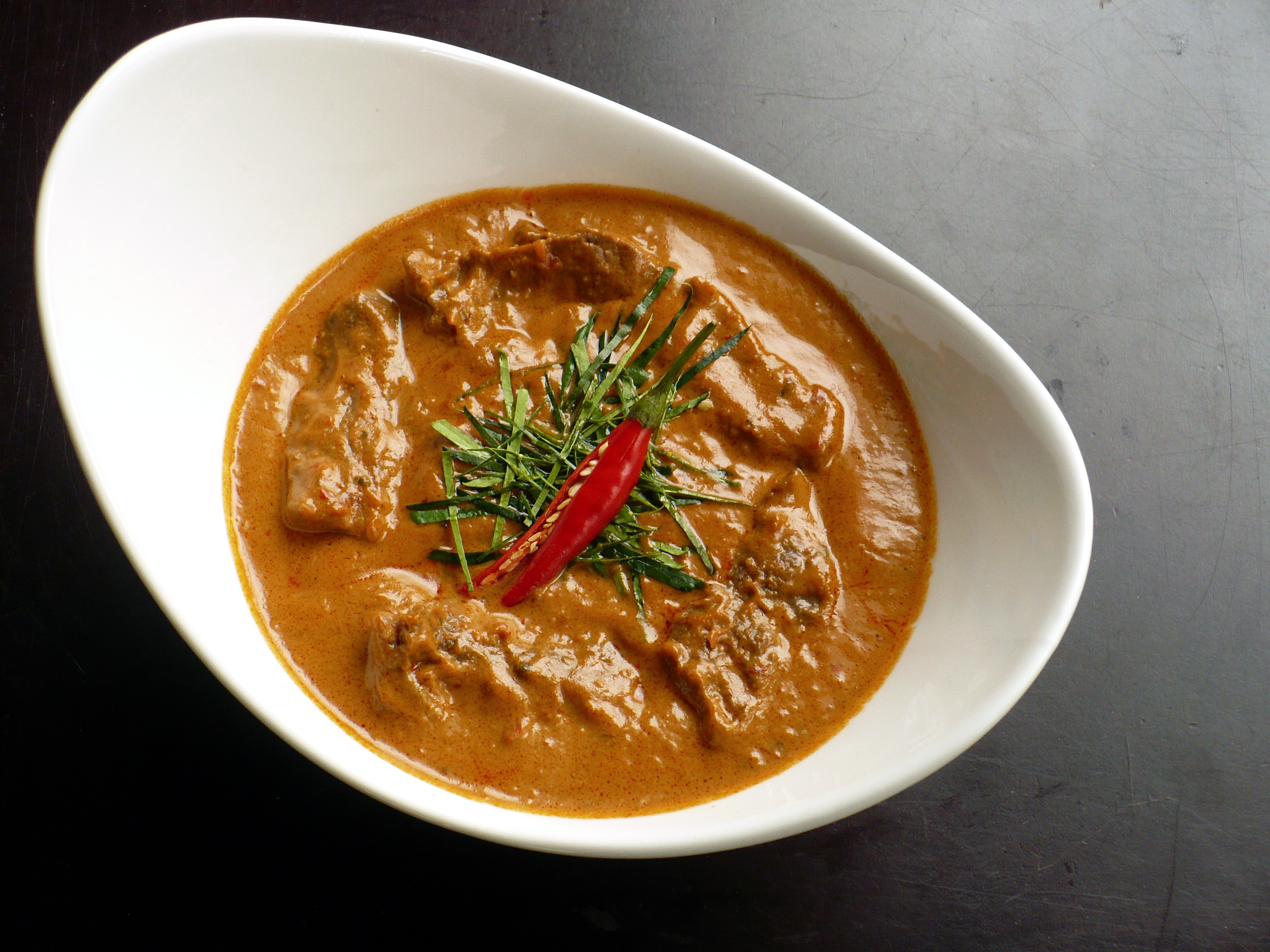 ... panang moo yang curried pork chops egg curry jungle curry cashew curry